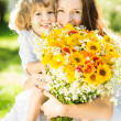 Happy family with spring flowers — Stock Photo #22150039