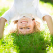 Active kid playing outdoors — Stok fotoğraf