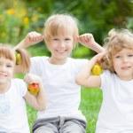 Happy active kids with apples — Stock Photo