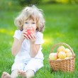 Child eating apple — Stock Photo #22150119