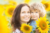 Happy family in sunflower field — Stock Photo