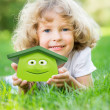 Happy child holding 3d house — Stock Photo