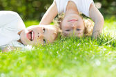 Happy children standing upside down — Stock Photo