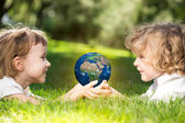 Earth in childrens hands — Zdjęcie stockowe