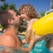 Child in swimming pool - Stock Photo