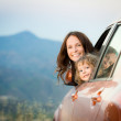 Happy family travel in car — Stockfoto #24242781