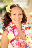 Woman in hawaiian flowers garland — Stock Photo