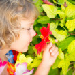 Child with tropic flower — Stock Photo