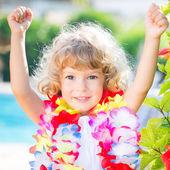 Happy child wearing hawaiian flowers garland — Stock Photo