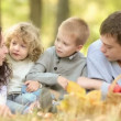 Happy family enjoying time together in the park during a beautiful autumn day — Vídeo Stock