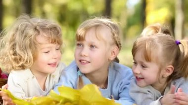 Three kids having fun in a park — Stock Video