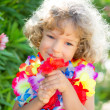 Royalty-Free Stock Photo: Child with tropic flower
