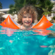 Stock Photo: Child in swimming pool