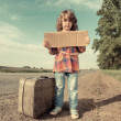 Lonely girl with suitcase — Stock Photo