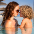 Family in swimming pool — Stock Photo