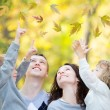 Happy family in autumn park — Stock Photo #26464789
