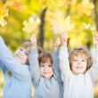 Children in autumn park — Stock Photo #26464813