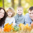 Happy family having picnic in autumn park — Stock Photo