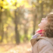 Happy child playing outdoors in autumn park — Stock Video