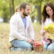 Happy family playing outdoors in autumn park — Stock Video #27295709