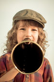 Kid shouting through megaphone — Stock Photo