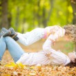 Happy family in autumn park — Stock Photo #30017233