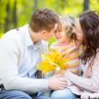 Happy family in autumn park — Stock Photo #30017241