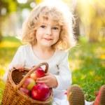 Child having picnic in autumn park — Stock Photo