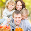 Happy family in autumn park — Stock Photo #30556457