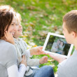 Family using tablet PC — Stock Photo