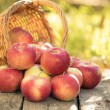 Red apples on wooden table — Stock Photo #30824951