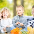 Family having picnic in autumn — Stock Photo