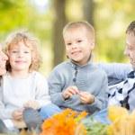 Family having picnic in autumn — Stock Photo
