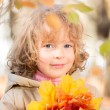 Child in autumn park — Stock Photo