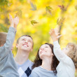 Family having fun in autumn — Stock Photo
