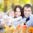 Happy family in autumn park — Stock Photo #30825765