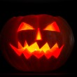 Scary halloween pumpkins jack-o-lantern candle lit — Stock Photo