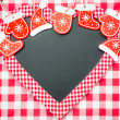 Card blank in heart shape with Christmas tree decorations — Foto de Stock