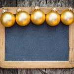 Border of gold Christmas balls — Stock Photo