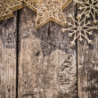 Gold Christmas tree decorations on grunge wood — Stock Photo #32633483
