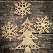 Gold Christmas tree decorations on grunge wood — Stock Photo #32633495