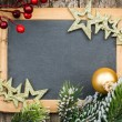 Vintage blackboard blank framed in Christmas tree branch and dec — Stock Photo