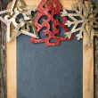 Christmas tree decorations border on vintage wooden blackboard — Stok fotoğraf