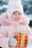 Happy child holding gift box — Stock Photo