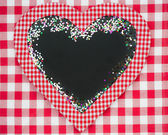 Card blank in heart shape with confetti — Stock Photo