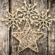 Gold Christmas tree decorations on grunge wood — Stock Photo #33133993