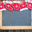 Christmas tree decorations border on vintage wooden blackboard — Stock Photo #33134057