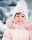Child in winter park — Stock Photo
