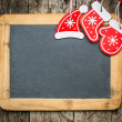 Christmas tree decorations on vintage wooden blackboard — Stockfoto