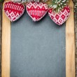 Christmas tree decorations border on vintage wooden blackboard — Stock Photo